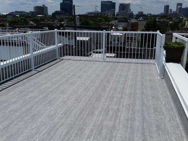 flat roof transformed into leisure deck with Duradek vinyl decking and Durarail aluminum railings