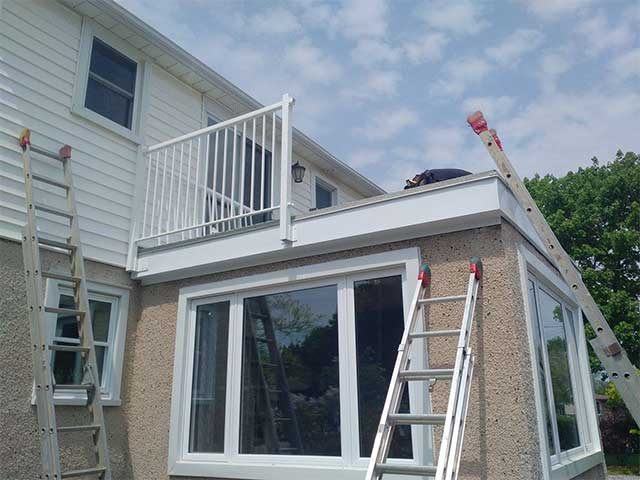 A leaky roof deck in Ontario being repaired
