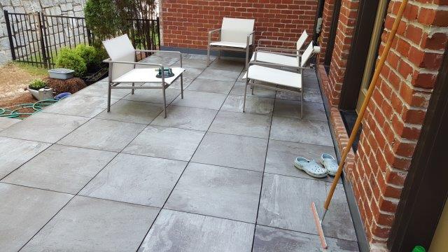 Finished tile deck waterproofed below by Duradek's Plazadek system