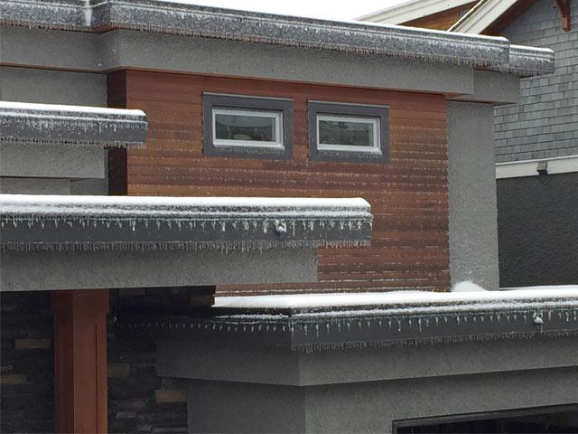 original high maintenance cedar cladding on house in winter