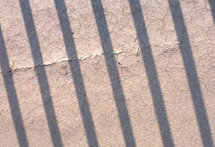 This liquid coating (behind the shadow of the railings) shows major cracking