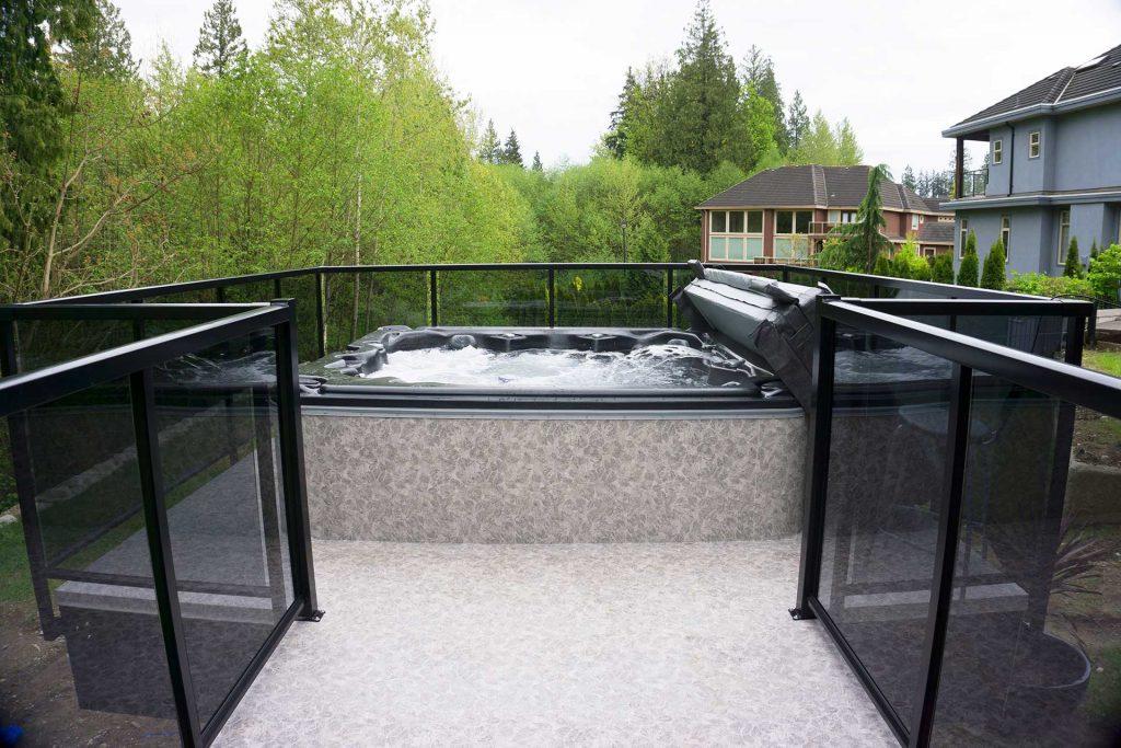 Duradek Forest Floor Alder Vinyl Decking Hot Tub Area with Glass Railing