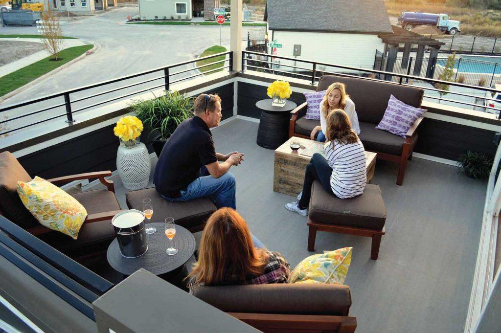 Family Enjoying Roof Deck Waterproofed with Duradek Legacy Driftwood Vinyl