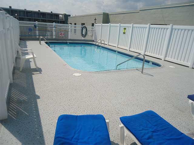Duradek Supreme Granite Chip vinyl on a pool surround.