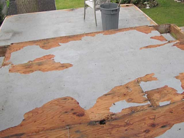 Plywood deck with peeling paint and water damage