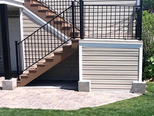 Dry outdoor storage under stairs with Duradek vinyl membrane