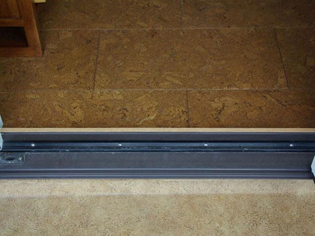Door threshold with natural cork indoor flooring and Duradek cork vinyl decking outside