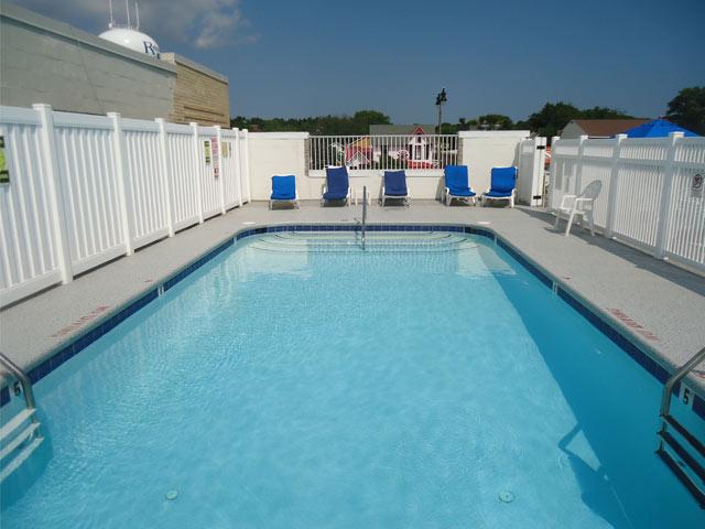 Pool Deck surfaced with Duradek Supreme Chip Granite vinyl decking