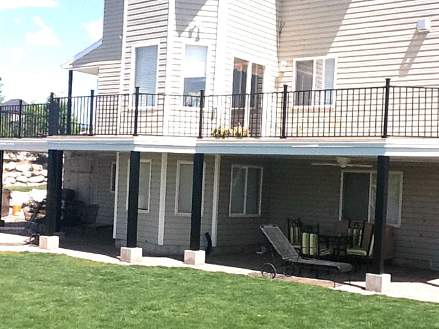 Second level Duradek deck over lower level shaded patio