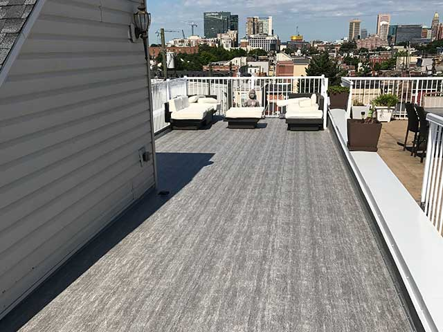 Extended Roof Deck with a View - After Duradek Driftwood Vinyl Membrane