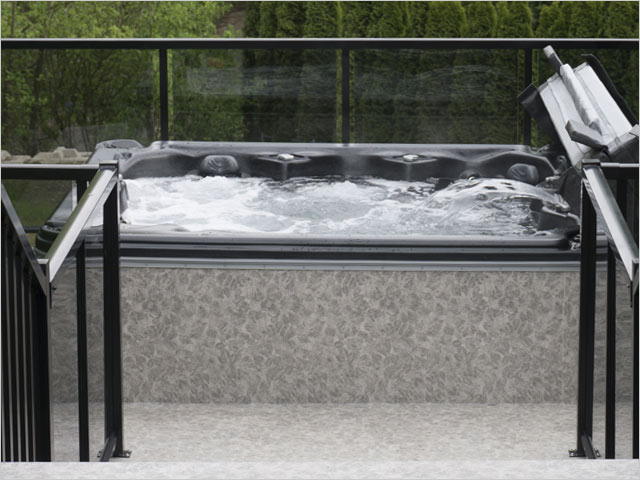 Hot tub covered in Duradek Forest Floor Ash