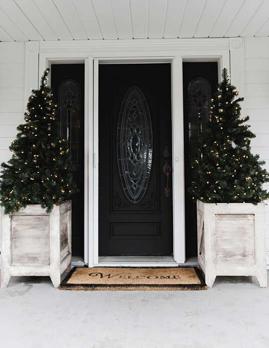 Decorate porch for Christmas with planters
