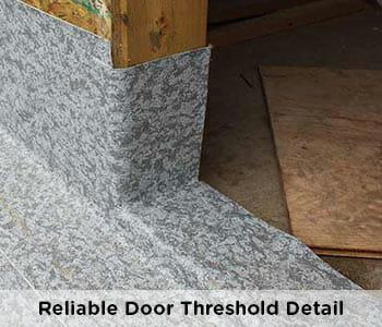 professional waterproofing detail at door threshold on vinyl decking installation