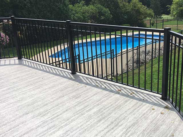 Surface mounted railings on vinyl deck
