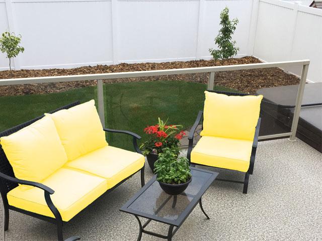 Duradek Legacy Pebble Beach vinyl decking with yellow accent furniture
