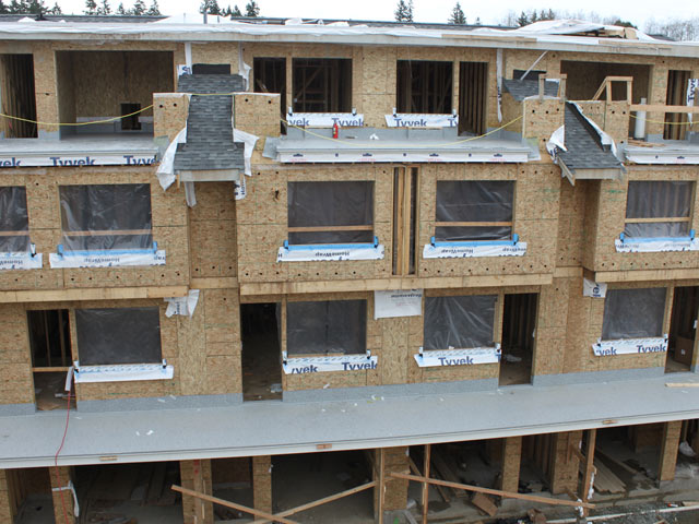 sequencing to integrate the PVC waterproof membrane into the building envelope on roof decks